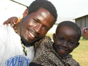 Morris founder of Atin Africa with street kid